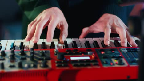 Fingers-of-a-musician-plays-an-electronic-piano